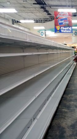 Empty shelves at a grocery store by Flickr user Chris Waits